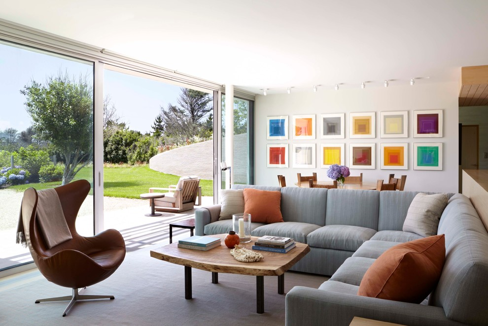 Inspiration for a large contemporary open concept and formal living room remodel in New York with white walls and a wall-mounted tv