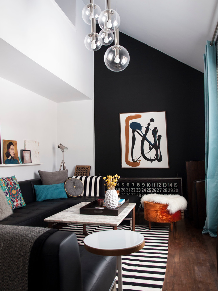 Example of a small trendy dark wood floor living room design in Montreal with black walls