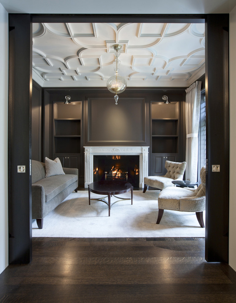 Elegant formal and enclosed dark wood floor living room photo in Chicago with gray walls, no tv and a standard fireplace