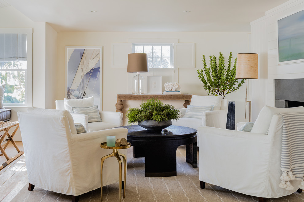 Inspiration for a transitional open concept light wood floor living room remodel in Boston with white walls, a standard fireplace, a stone fireplace and a concealed tv