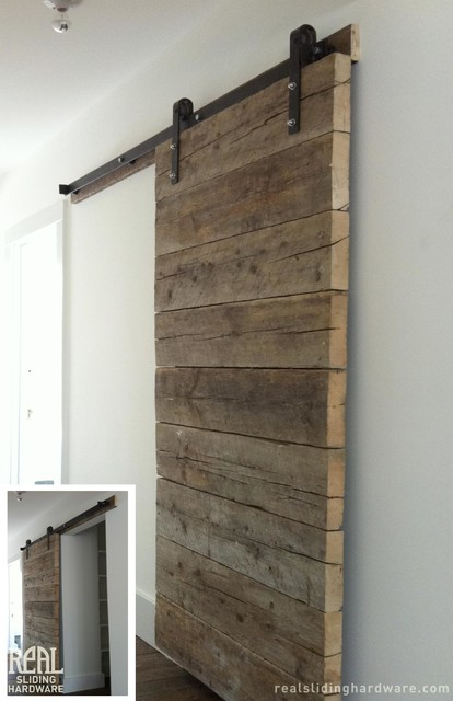 Salvaged plank custom barn doors rustic living room for Real carriage hardware