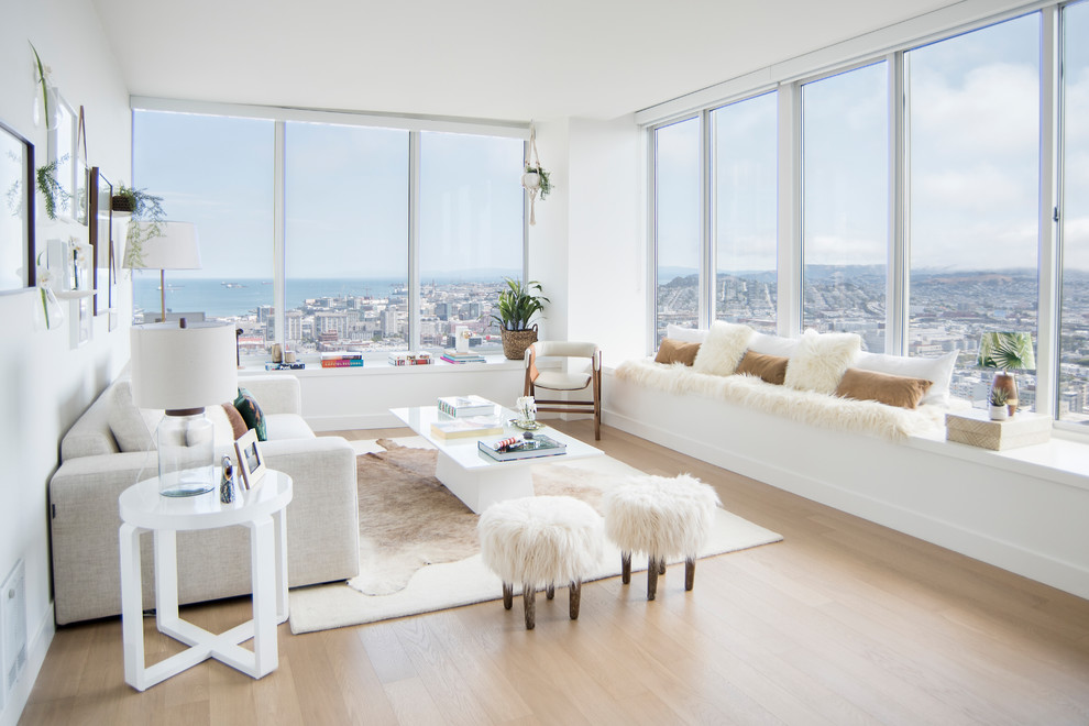 Example of a mid-sized danish formal and open concept light wood floor and beige floor living room design in Miami with white walls, no fireplace and no tv