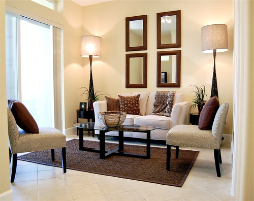 Hang Several Mirrors With The Same Shape Size And Style Serve As Accent Pieces To Cream Wall Make Room Look Taller This Living