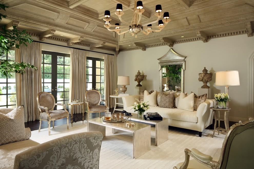 Living room - large victorian formal and enclosed dark wood floor and brown floor living room idea in Los Angeles with no fireplace, a wall-mounted tv and beige walls