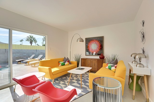 Medium sized midcentury open plan living room in Phoenix with white walls and concrete flooring.