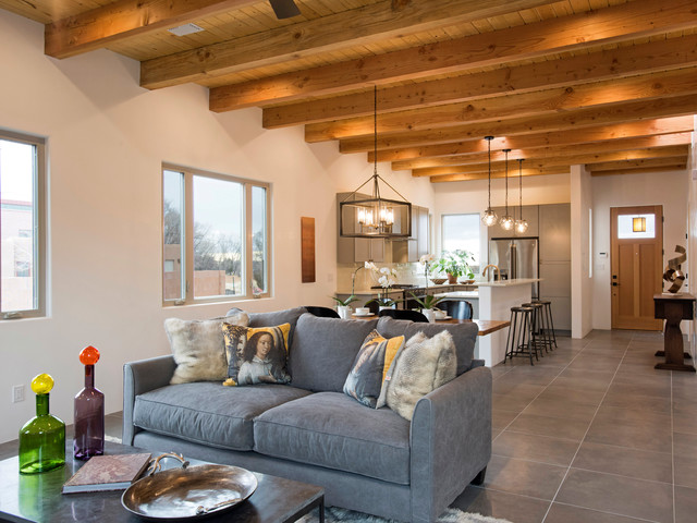 Living room - mid-sized southwestern open concept gray floor living room idea in Albuquerque with a two-sided fireplace and a tile fireplace