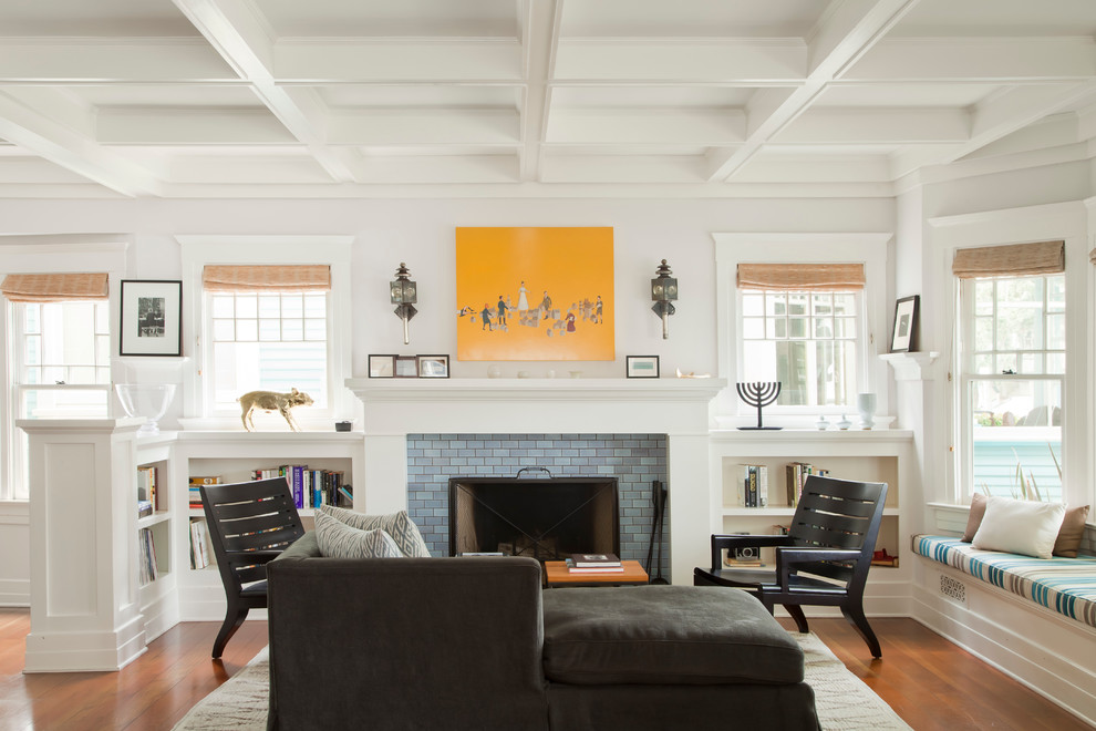 Beach style living room photo in Los Angeles with white walls, a standard fireplace and a tile fireplace