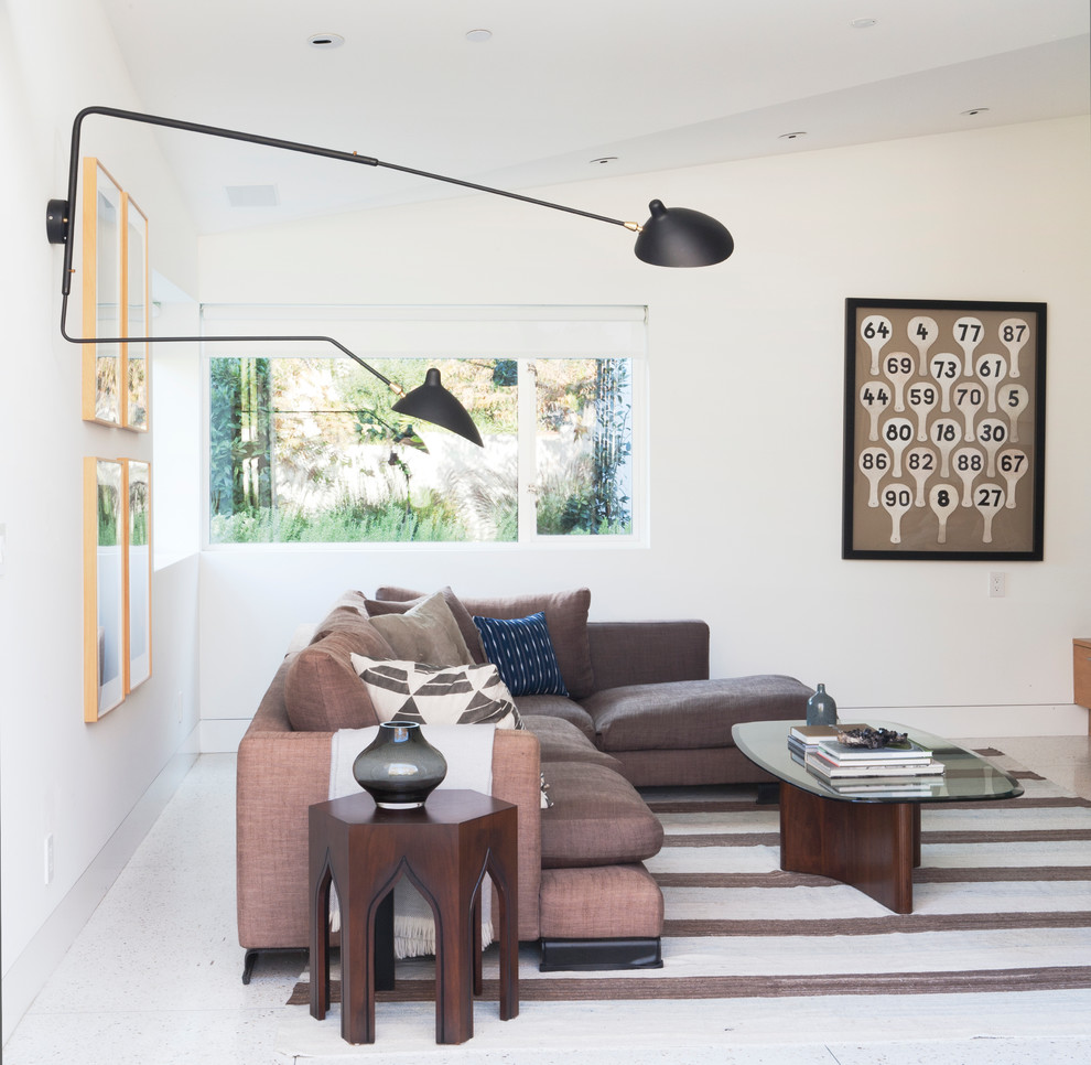 Example of a trendy living room design in Los Angeles with white walls