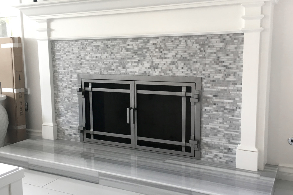 Example of a large trendy formal and open concept porcelain tile and white floor living room design in San Diego with white walls, a standard fireplace, a tile fireplace and no tv