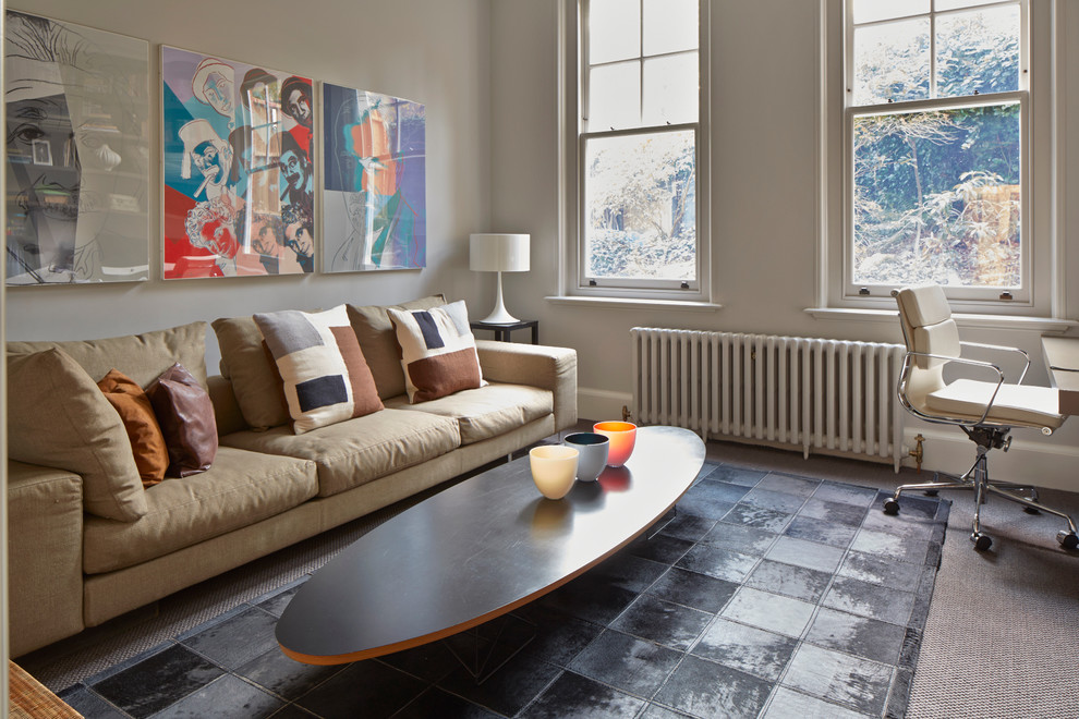 Inspiration for a large scandinavian formal carpeted living room remodel in London with gray walls and no fireplace