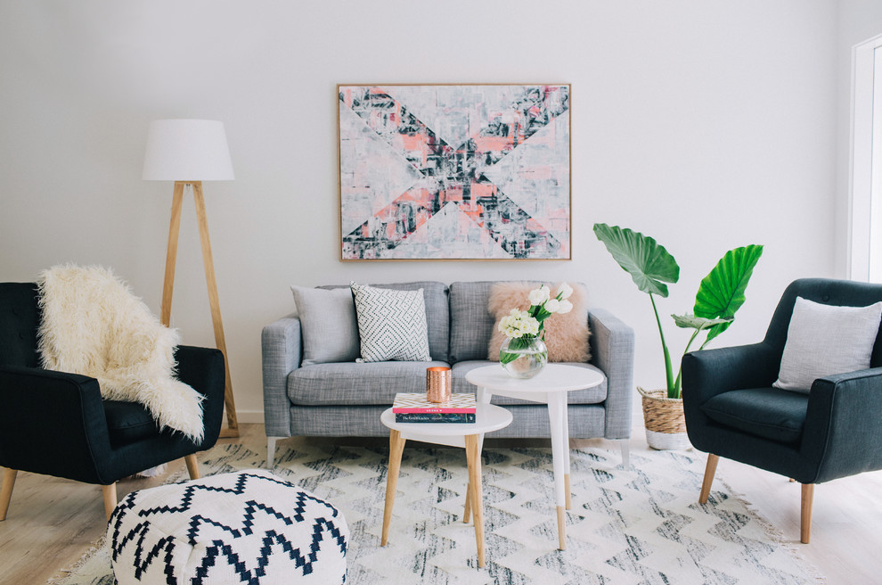 Example of a danish formal light wood floor living room design in Sydney with gray walls