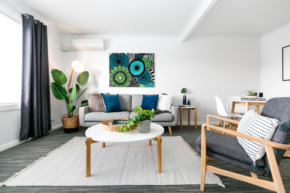 Example of a danish formal and open concept carpeted and gray floor living room design in Hobart with white walls