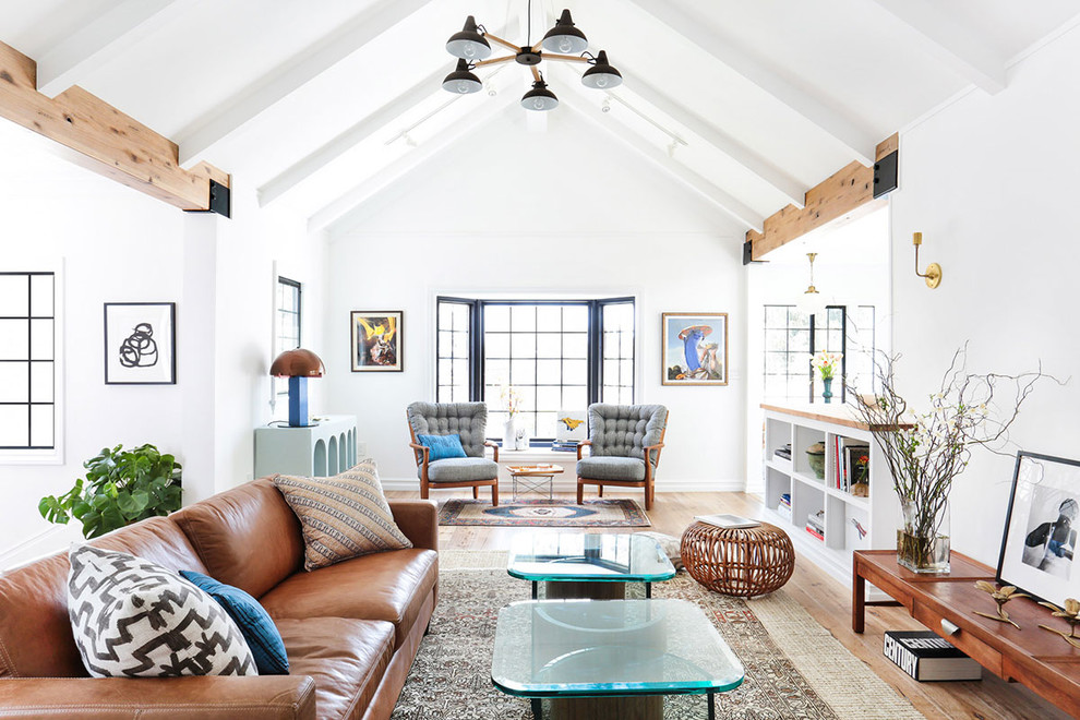 Living room - large scandinavian open concept light wood floor living room idea in Los Angeles with white walls, no tv and no fireplace