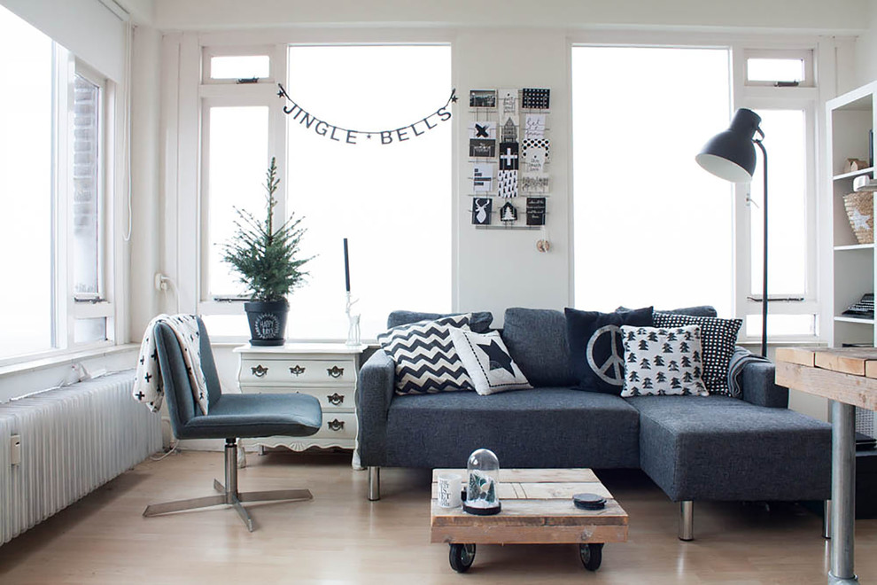 Inspiration for a scandinavian living room remodel in Amsterdam with white walls, no fireplace and no tv