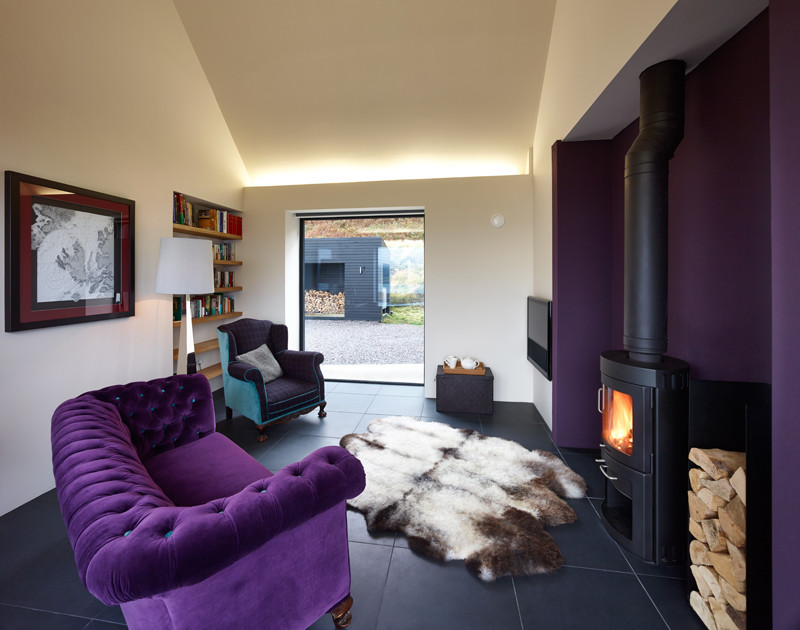 Living room - mid-sized contemporary living room idea in Other with purple walls and a wall-mounted tv