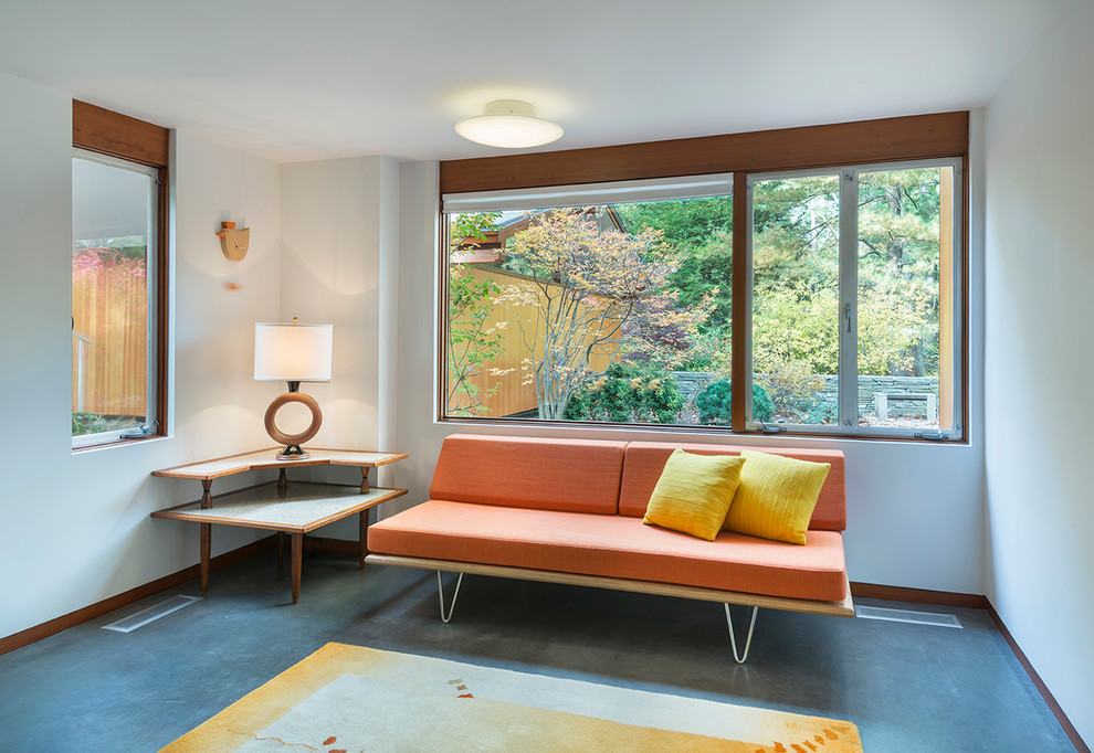 1960s formal concrete floor living room photo in Boston with white walls, no fireplace and no tv