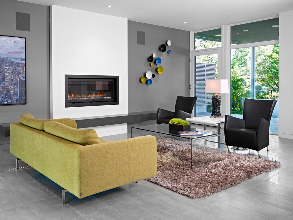 Inspiration for a modern porcelain tile and gray floor living room remodel in Edmonton with gray walls