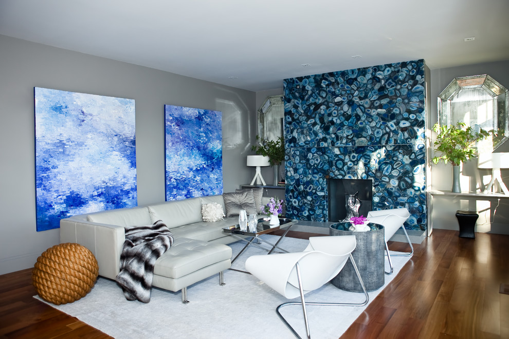 Inspiration for a modern living room remodel in San Francisco with gray walls and a stone fireplace
