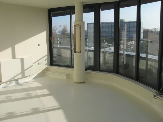 SEAMLESS WHITE POURED RUBBER RESIN FLOORING FOR GREENWICH PENTHOUSE LONDON contemporary-living-room