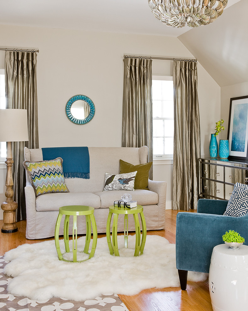 Inspiration for a transitional medium tone wood floor living room remodel in Boston with beige walls and no tv