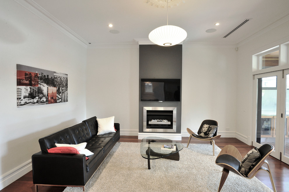 Living room - contemporary dark wood floor living room idea in Perth with white walls, a standard fireplace, a metal fireplace and a wall-mounted tv