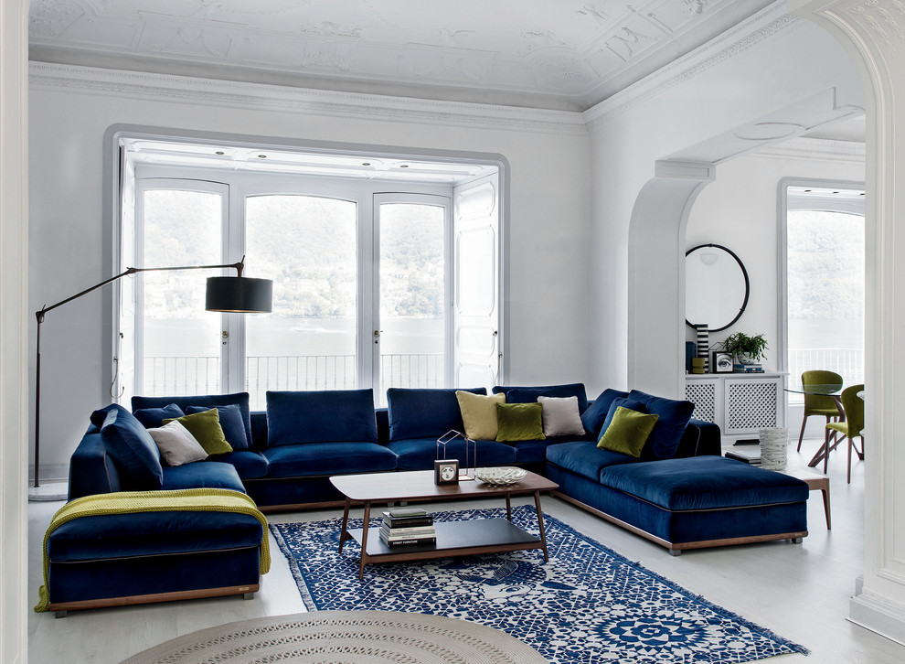 Example of a trendy light wood floor and white floor living room design in Miami with white walls and no tv