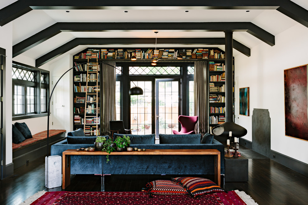 Arts and crafts dark wood floor and black floor living room library photo in Portland with a hanging fireplace, no tv and white walls
