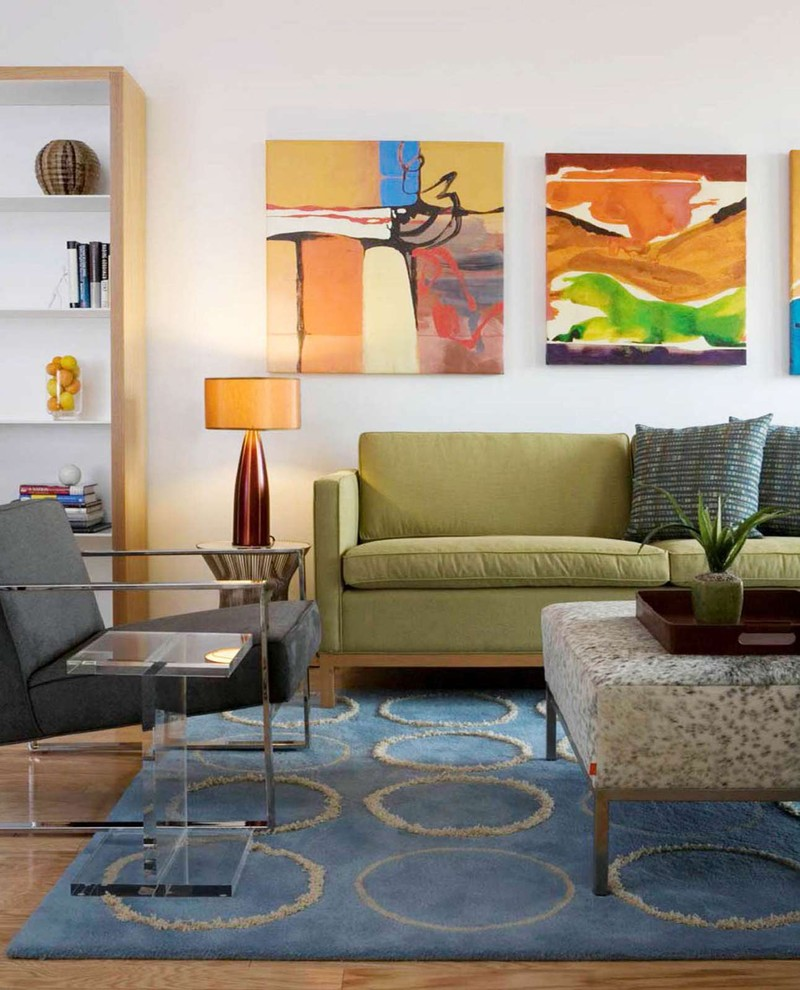 Inspiration for an eclectic living room remodel in DC Metro with white walls