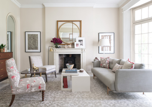 Living room - small contemporary living room idea in Delhi with beige walls and a standard fireplace