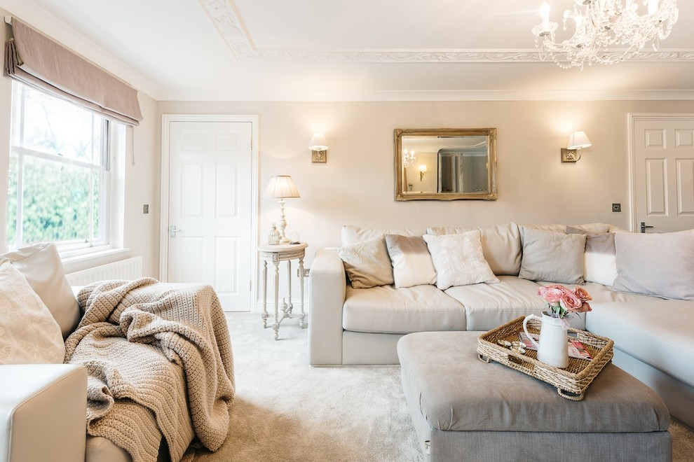Inspiration for a timeless enclosed carpeted living room remodel in Cambridgeshire with beige walls