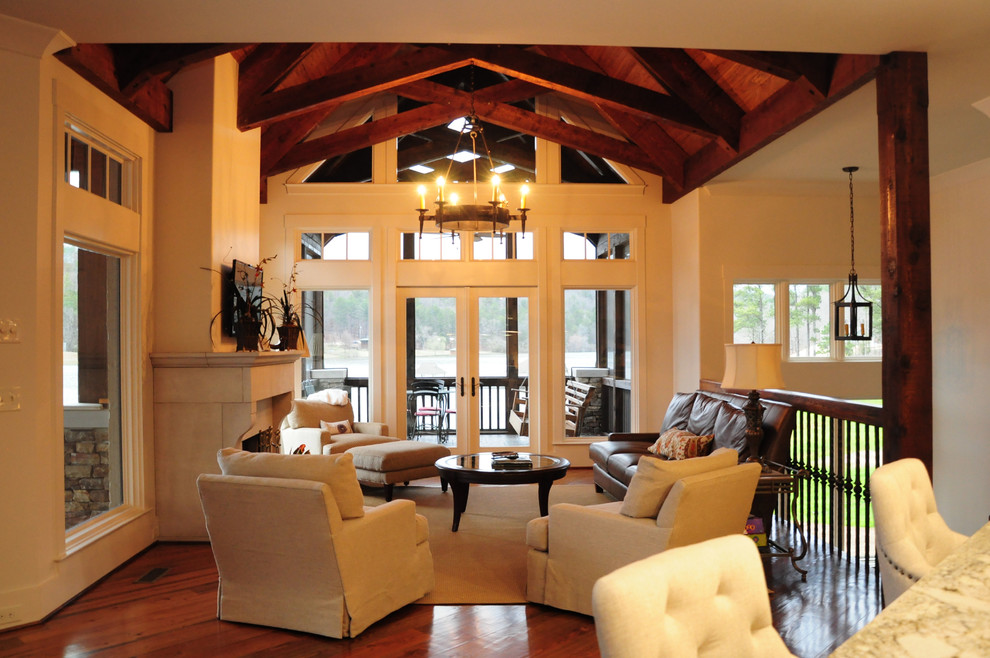 Example of a large transitional open concept and formal dark wood floor living room design in Birmingham with white walls, a standard fireplace, a stone fireplace and a wall-mounted tv