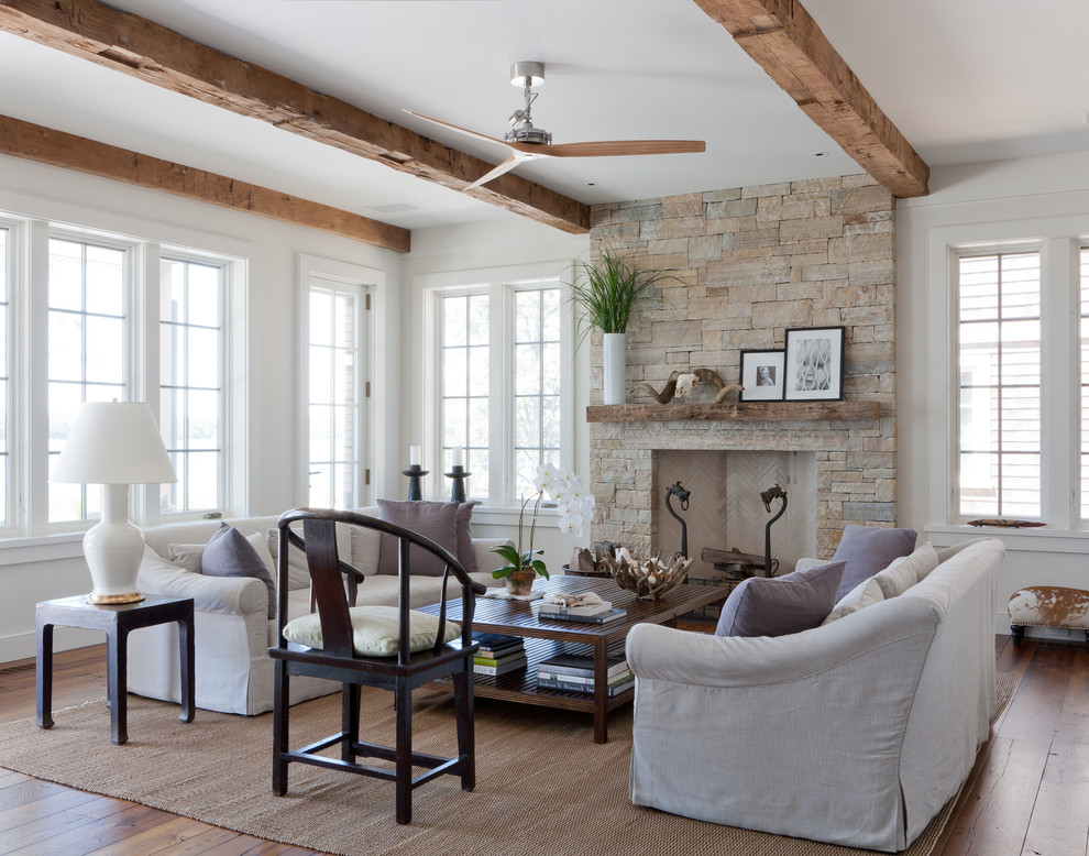 Inspiration for a beach style living room remodel in New York with a stone fireplace