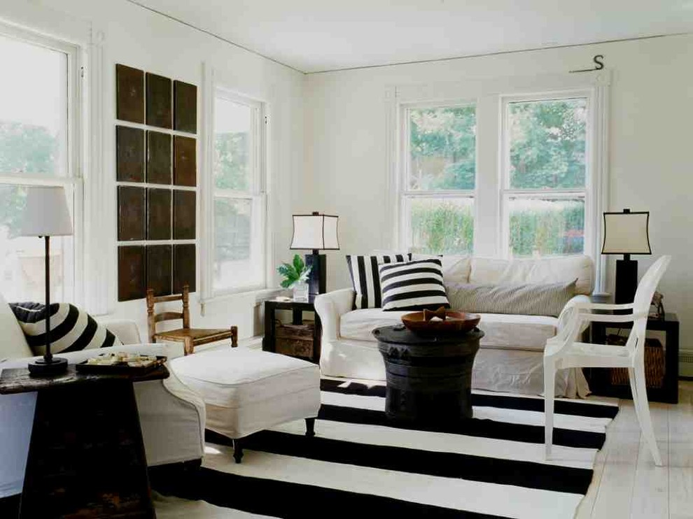 Inspiration for a shabby-chic style living room remodel in New York with white walls