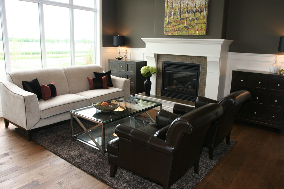 Inspiration for a small timeless open concept dark wood floor living room remodel in Other with brown walls, a standard fireplace and a tile fireplace