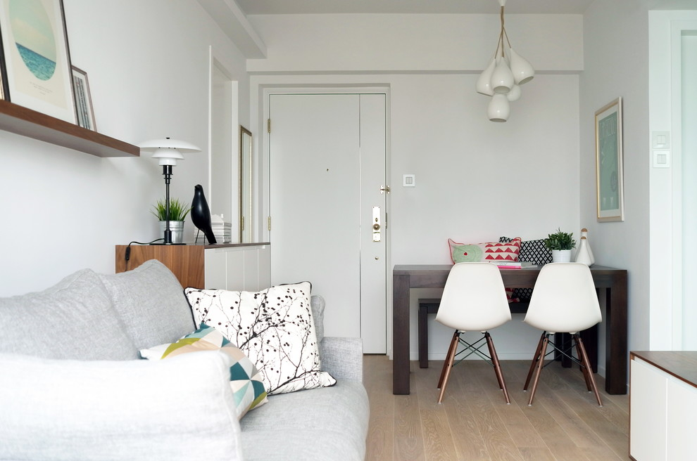 Example of a small minimalist living room design in Hong Kong with white walls