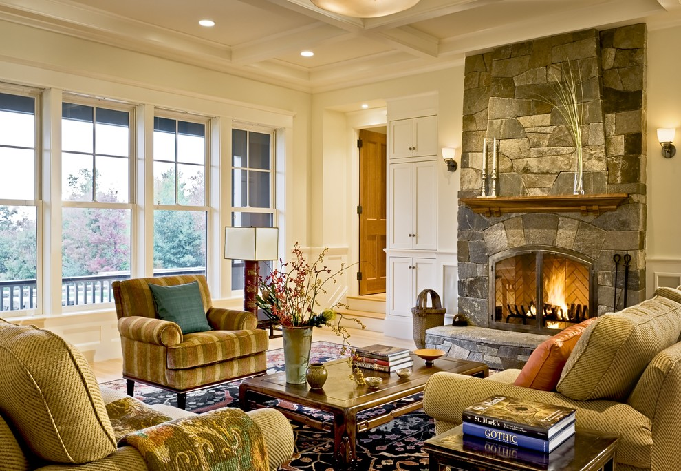 Living room - victorian living room idea in Burlington with a stone fireplace