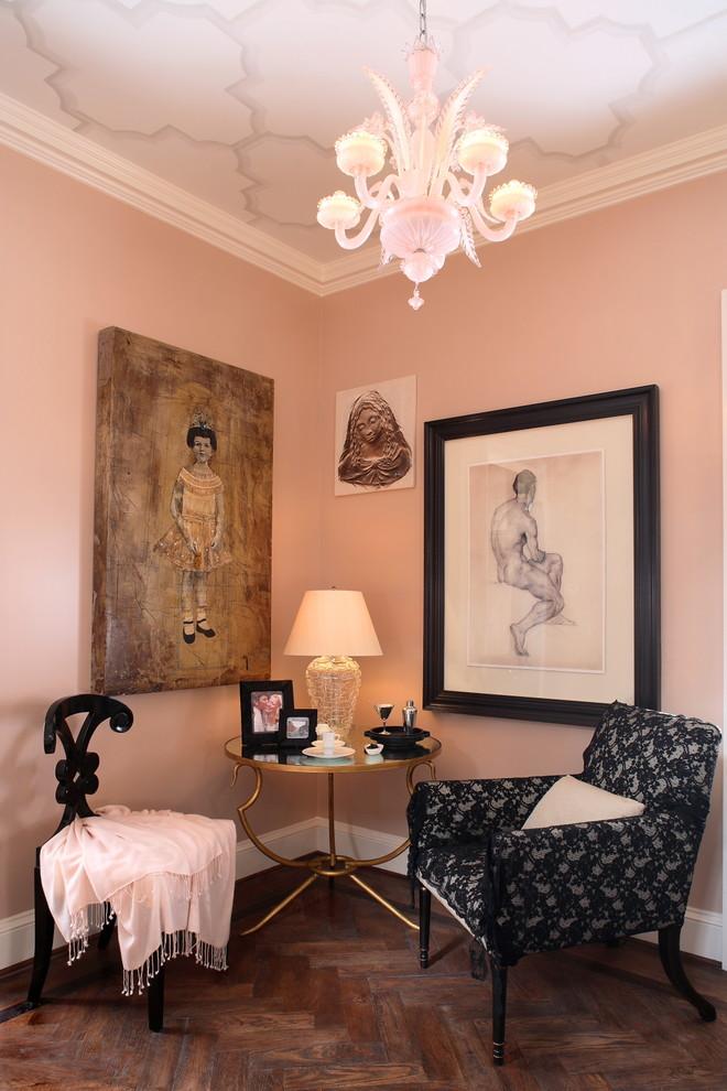 Living room - eclectic brown floor living room idea in Atlanta with pink walls