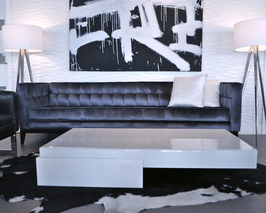 Showroom Pieces - living room setup featuring a white lacquer coffee table imported from Brazil
