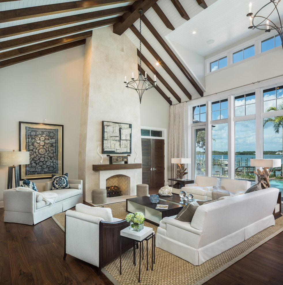 Inspiration for a huge contemporary open concept and formal dark wood floor living room remodel in Tampa with beige walls, a standard fireplace, a stone fireplace and no tv