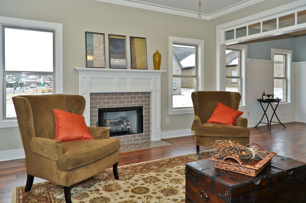 Living room - traditional living room idea in Birmingham with a tile fireplace