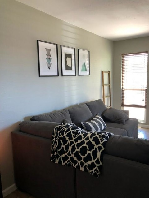 Inspiration for a mid-sized transitional loft-style ceramic floor and beige floor living room remodel in Phoenix with gray walls and no fireplace