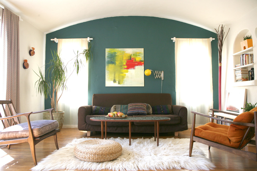 Living room - eclectic living room idea in Los Angeles with white walls