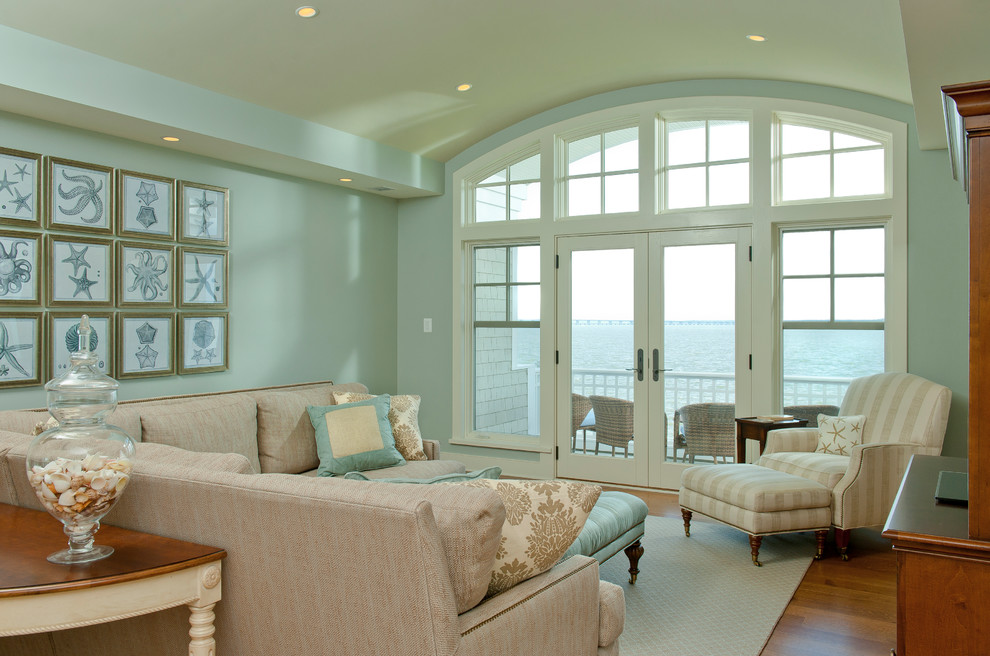 Example of a beach style formal and enclosed medium tone wood floor living room design in Baltimore with blue walls