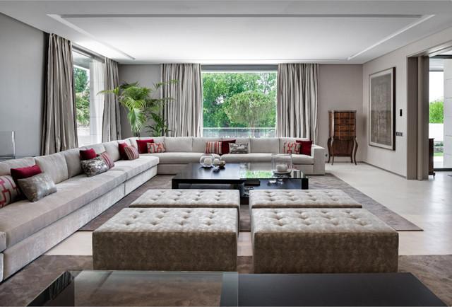 Immagine di un ampio soggiorno contemporaneo con pareti grigie