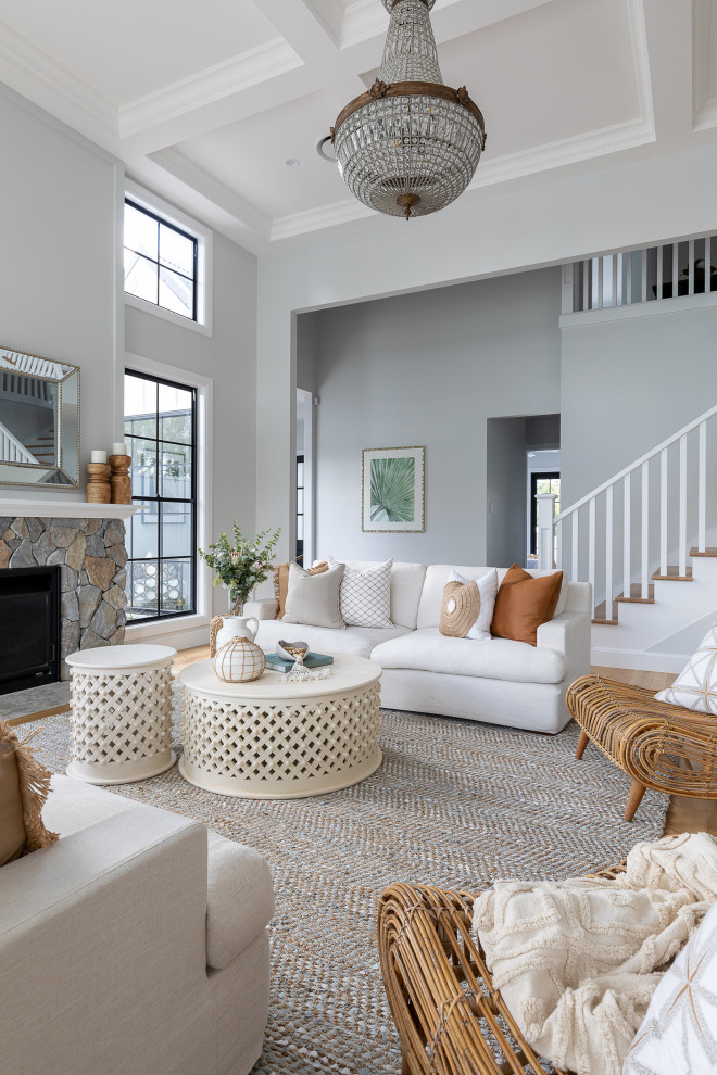 Inspiration for a transitional open concept living room in Brisbane with grey walls, medium hardwood floors, a standard fireplace, a stone fireplace surround and brown floor.