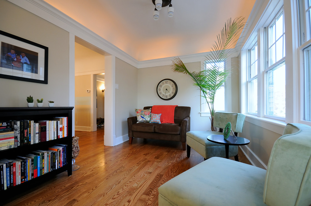 Living room - traditional medium tone wood floor living room idea in Chicago with beige walls