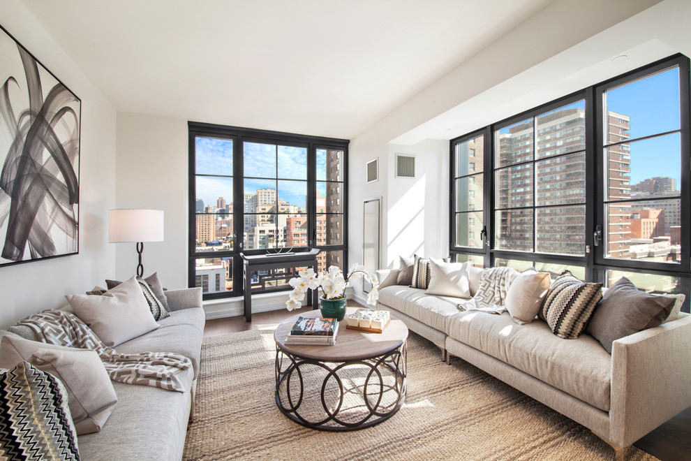 Transitional formal and enclosed dark wood floor and brown floor living room photo in New York with beige walls and no tv