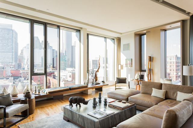Inspiration for a contemporary open concept medium tone wood floor living room remodel in Boston