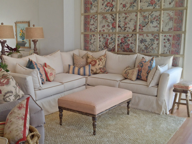 Slipcovered Cream Sectional With Floral Pillows Farmhouse living room