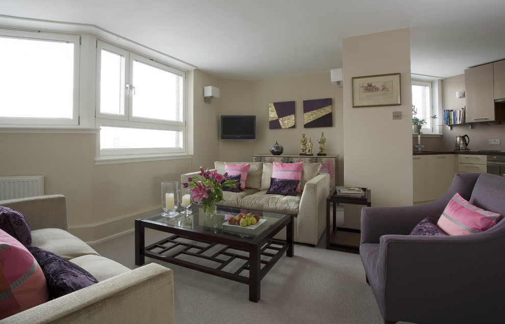 Example of a mid-sized eclectic living room design in London with beige walls